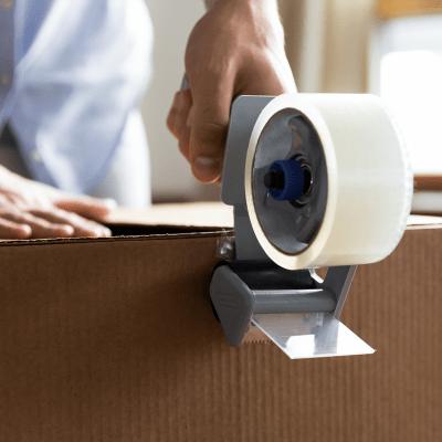 Sealing a box with packing tape atA-American Self Storage in Hemet, California