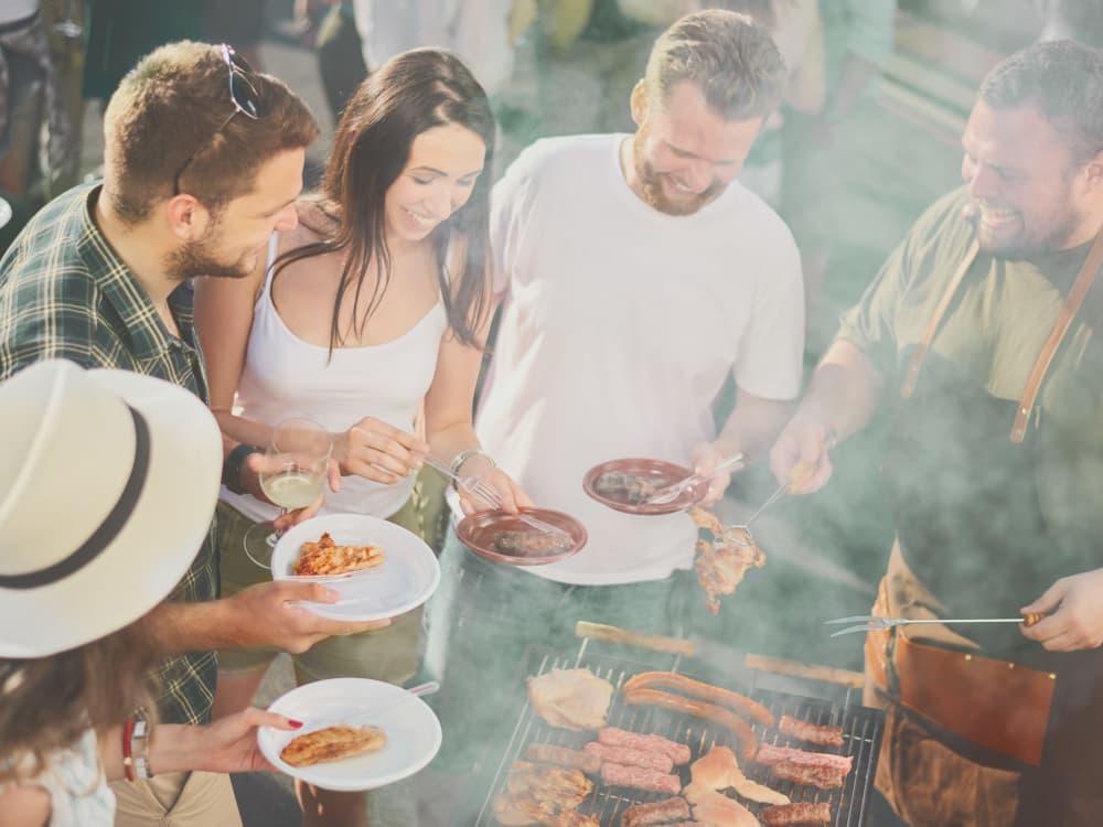 Residents enjoying fresh barbecue near Villa Vita Apartments in Peoria, Arizona