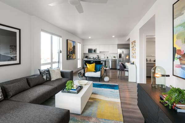 Spacious living room and upgraded kitchen space at Hudson on Farmer in Tempe, Arizona