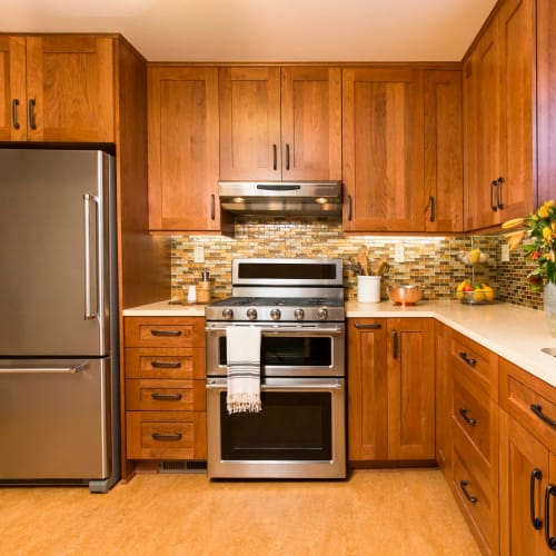 Stainless-steel appliances in a model home's kitchen at Olympus Court Apartments in Bakersfield, California