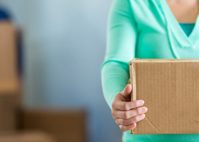 A woman holding a box at EZ Storage in Des Moines, Iowa