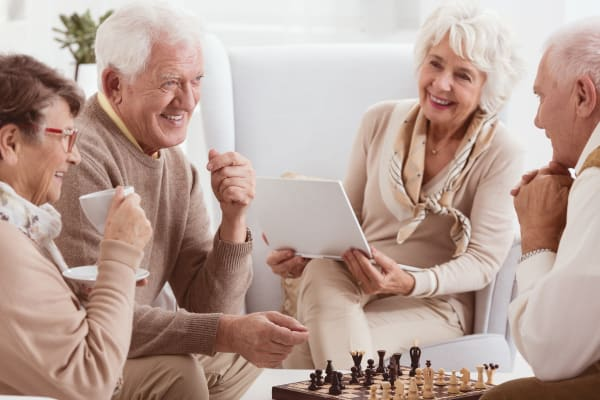 senior living residents playing games together and having fun in michigan city indiana