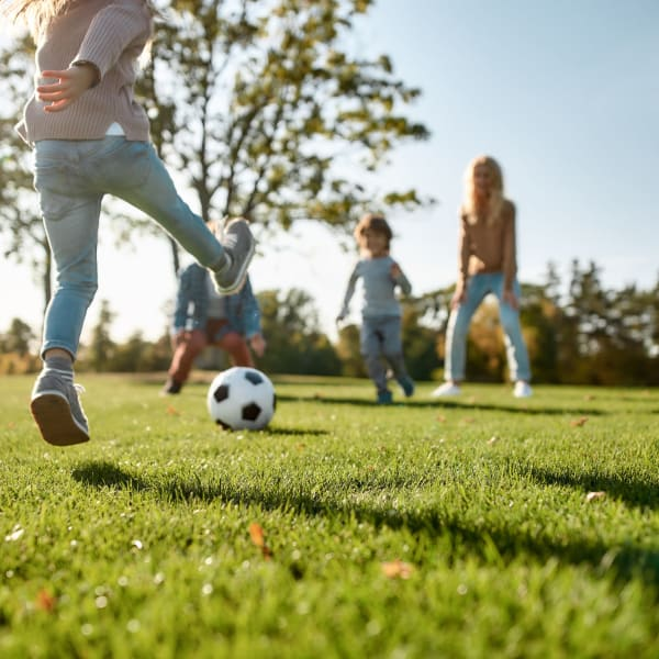 Children playing soccer near Palmetto Greens Apartment Homes in Covington, Louisiana