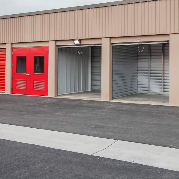 Red doors on open outdoor units at StorQuest Self Storage in Port St Lucie, Florida