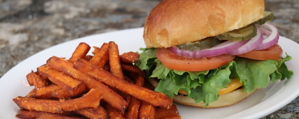 Burger with sweet potato fries at The Springs at Sherwood in Sherwood, Oregon