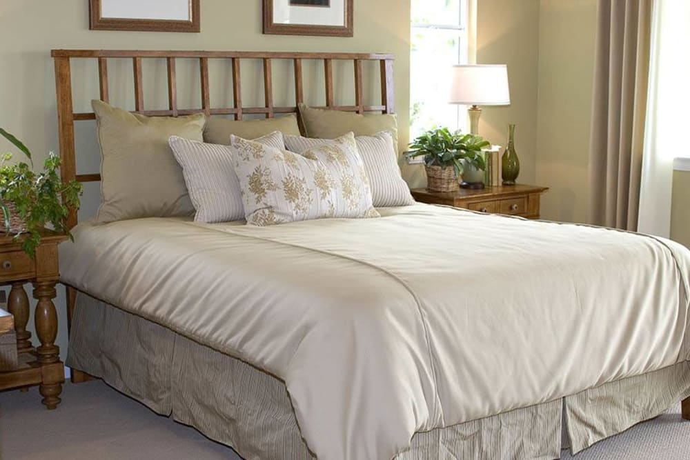 A beautifully decorated bedroom at Brightwater Senior Living of Highland in Highland, California