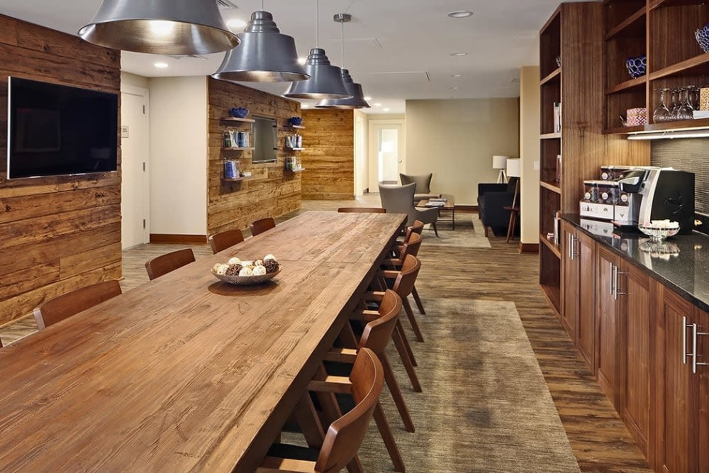Dining area with hardwood flooring and accents at Maplewood at Stony Hill in Bethel, Connecticut