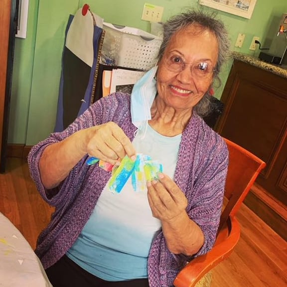 A Gilroy resident shows off her brand new custom gift tag!