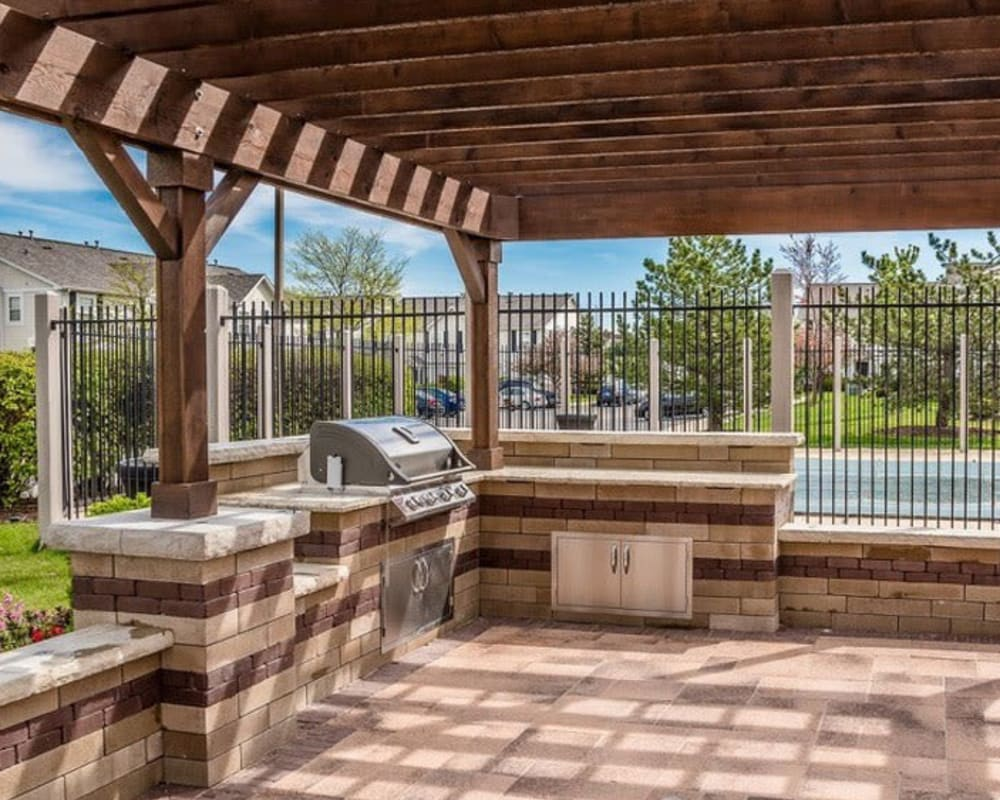 An outdoor grill area at Lakeview Townhomes at Fox Valley in Aurora, Illinois