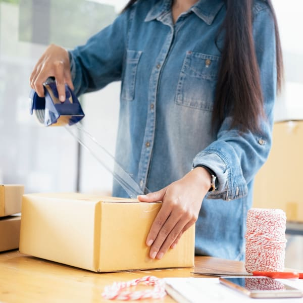 Woman using packing supplies from Seaport Storage in Tampa, Florida