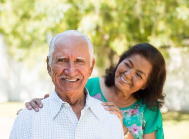 Two residents smiling at Mirror Lake Village Senior Living Community in Federal Way, Washington.
