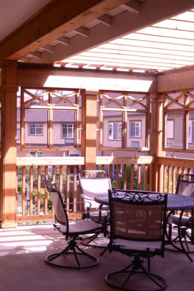 2nd floor balcony with tables and chairs at Quail Park at Browns Point in Tacoma, Washington