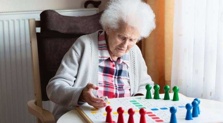 Senior woman playing board game