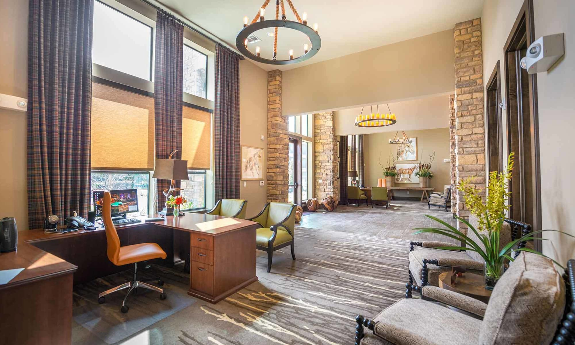 The Abbey at Spring Town Center leasing office interior with comfortable seating and beautiful decorations