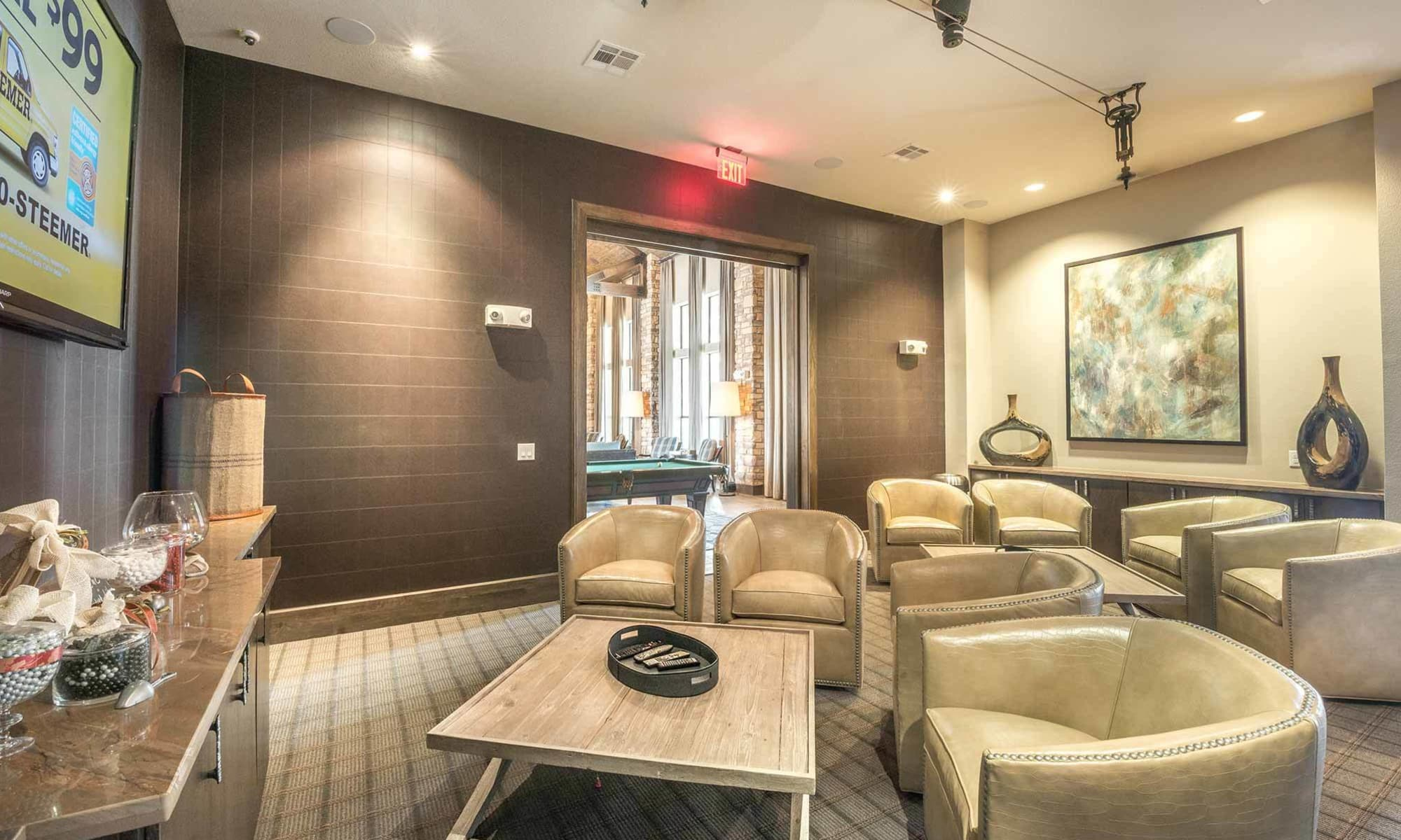 Plenty of comfortable seating in The Abbey at Spring Town Center clubhouse for viewing the big game on the widescreen tv