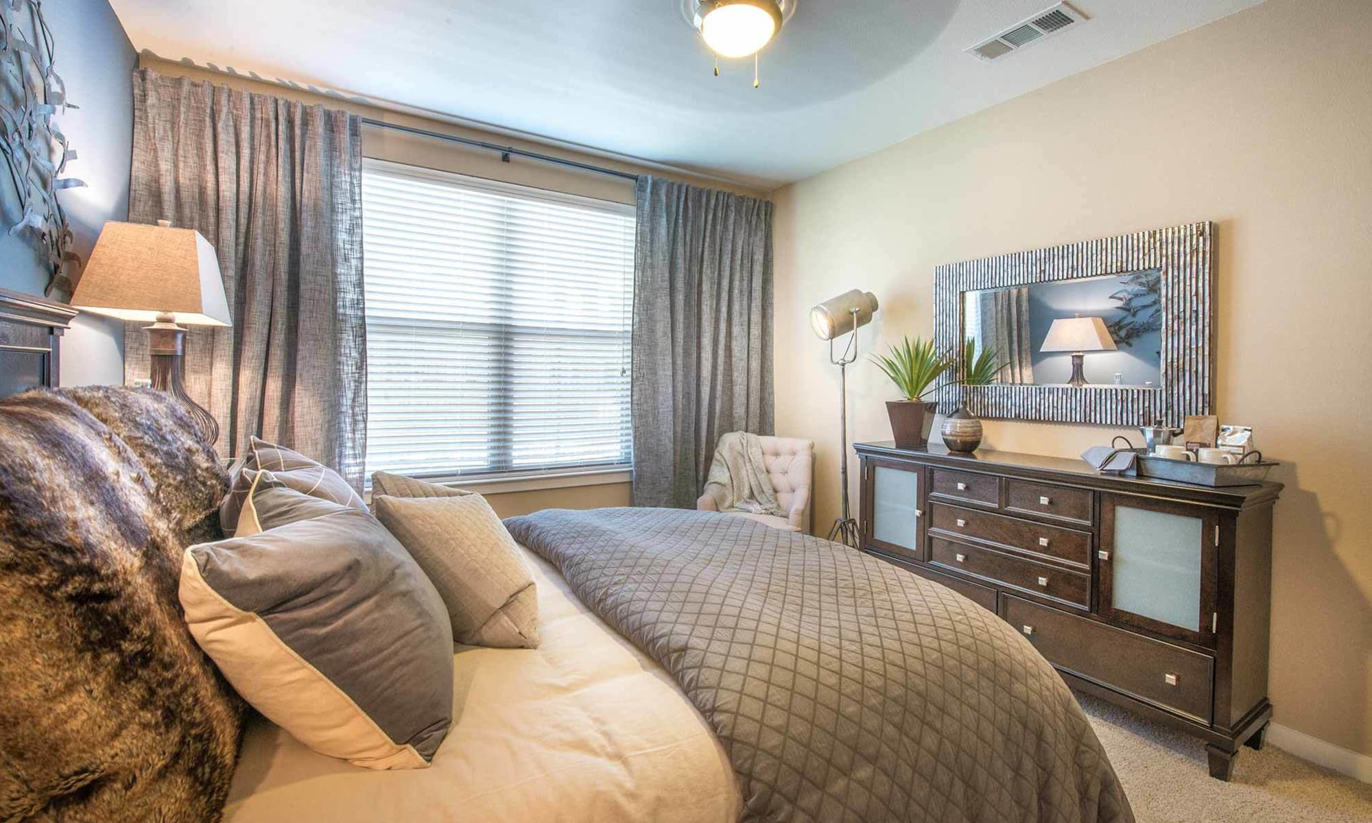 Spacious and well-decorated bedroom at The Abbey at Spring Town Center in Spring