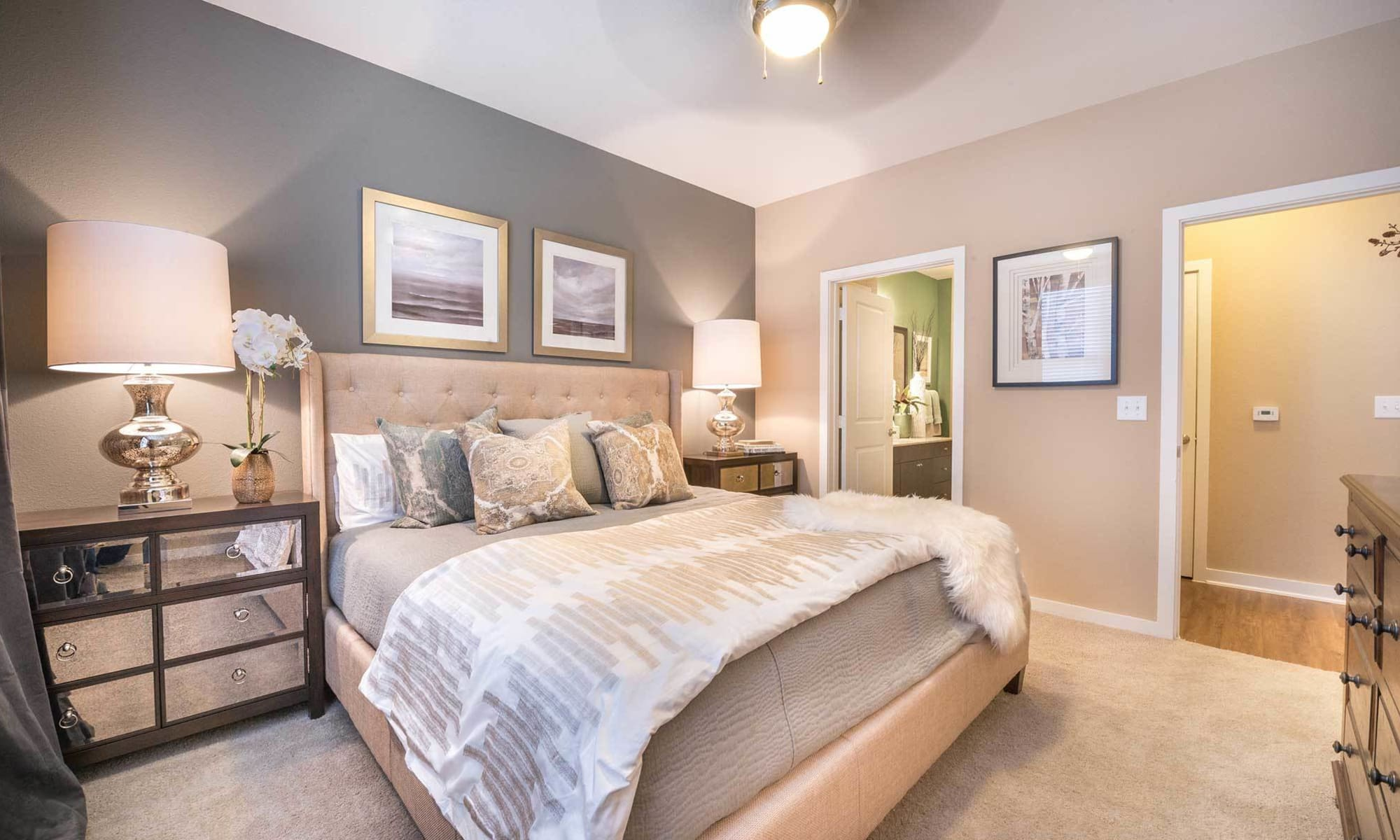 Wide-angle view of master bedroom in gorgeous model apartment at The Abbey at Spring Town Center