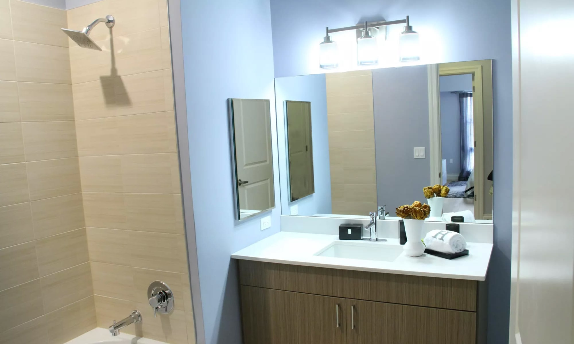 Spacious bathroom in model home at The Harper at Harmon Meadow