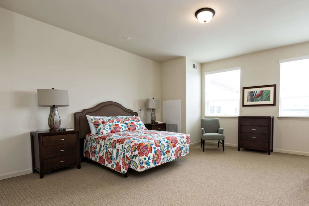 A large bedroom at The Harmony Collection at Hanover - Assisted Living & Memory Care in Mechanicsville, Virginia