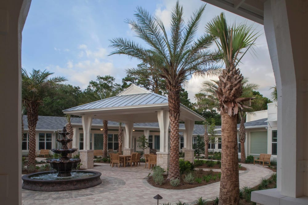 A paved walkway through the courtyard at Ponte Vedra Gardens Alzheimer's Special Care Center in Ponte Vedra Beach, Florida