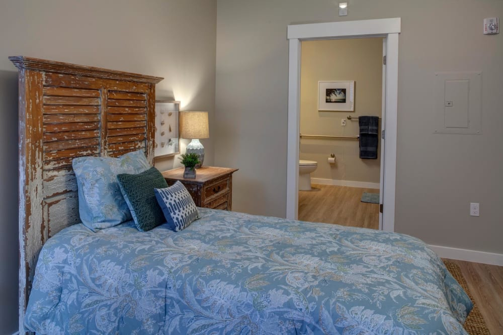 An apartment bedroom at Ponte Vedra Gardens Alzheimer's Special Care Center in Ponte Vedra Beach, Florida