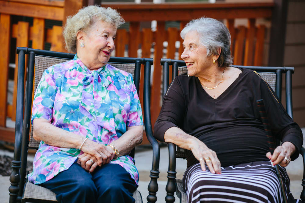 Two residents taking with each other at The Springs at Missoula in Missoula, Montana.