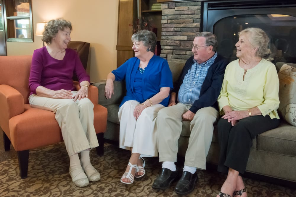 Residents sitting by fireplace in lounge at The Springs at Wilsonville in Wilsonville, Oregon
