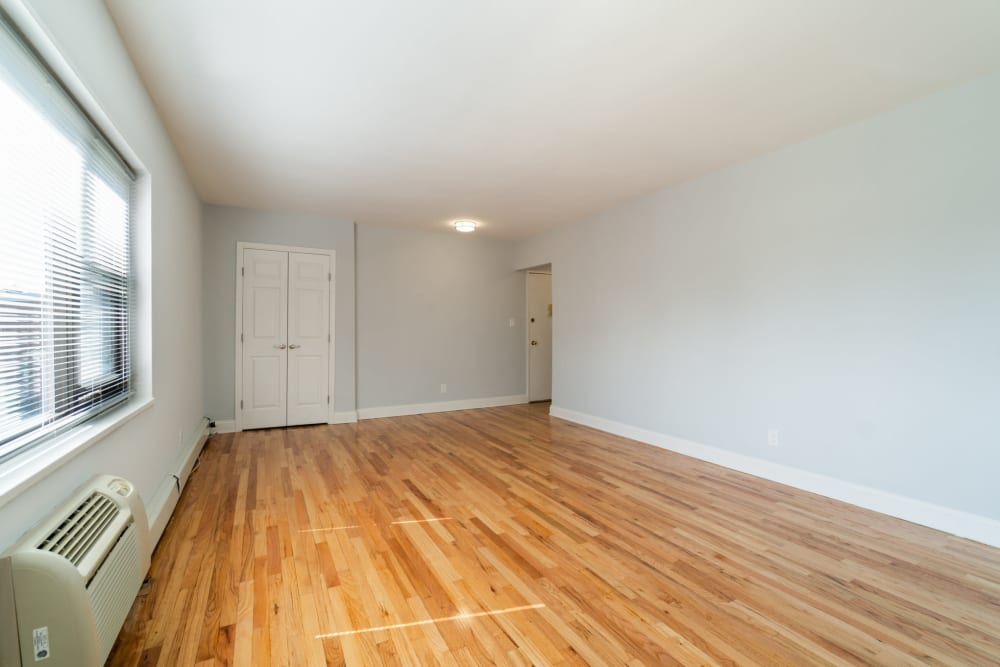 Bedroom with hardwood flooring at Eagle Rock Apartments at Hicksville in Hicksville, New York