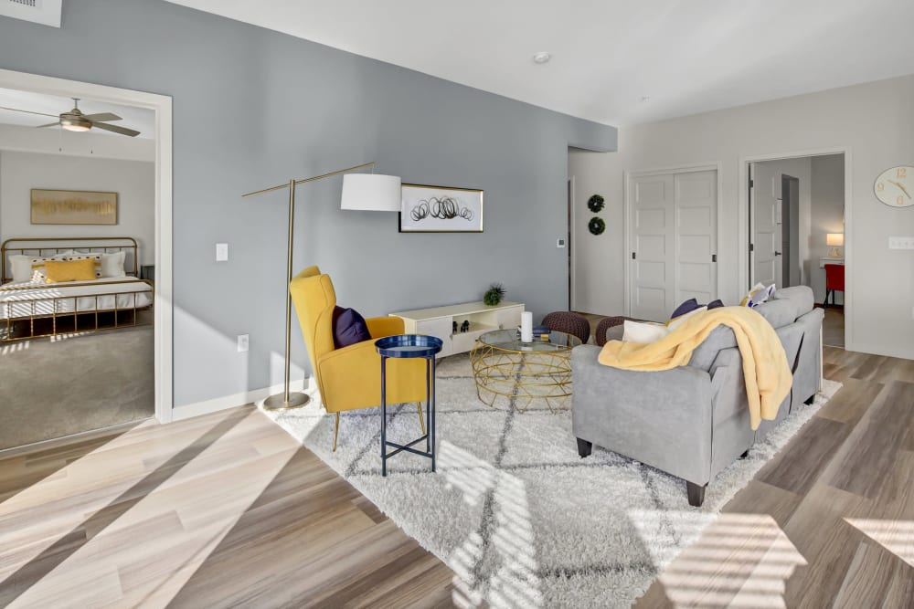 A comfortable clubhouse lounge with bar seating at Novo Apartments in Richfield, Minnesota