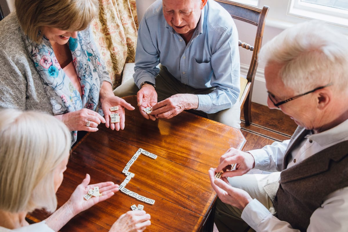 Residents playing a game together at The Oxford Grand Assisted Living & Memory Care in McKinney, Texas
