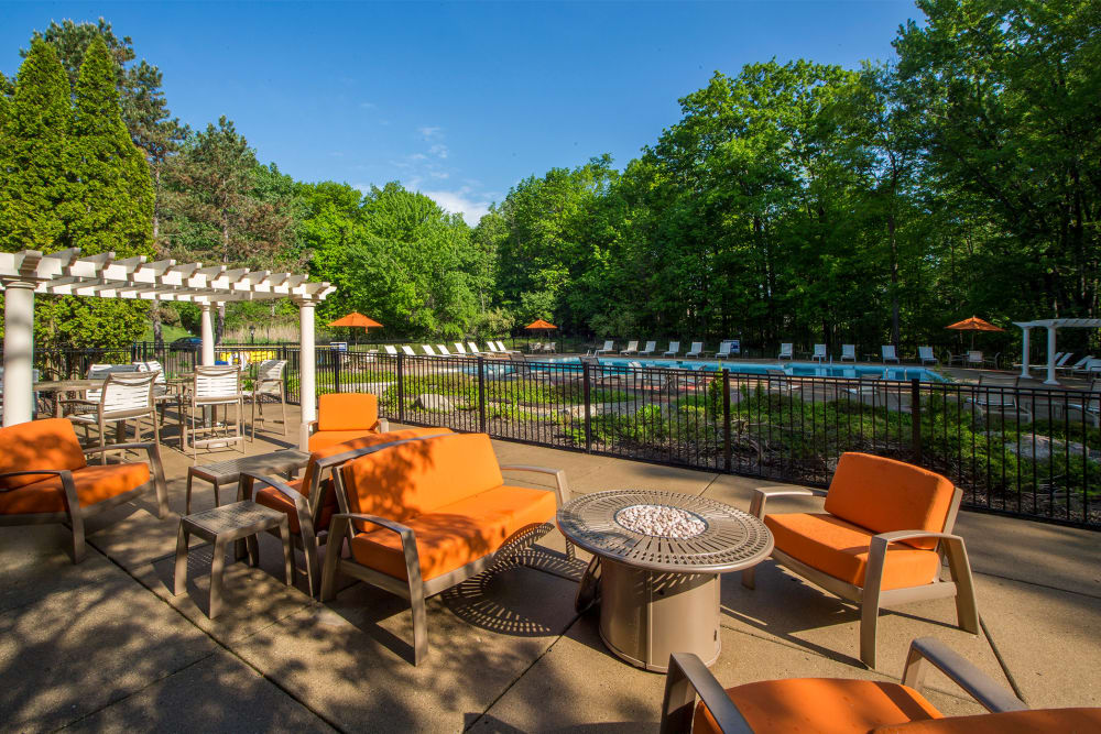 Outdoor furniture with view of water at Aldingbrooke in West Bloomfield, Michigan