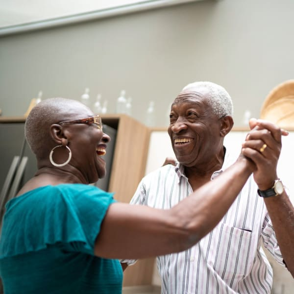 A resident couple dancing at Chesapeake Place Senior Living in Chesapeake, Virginia.