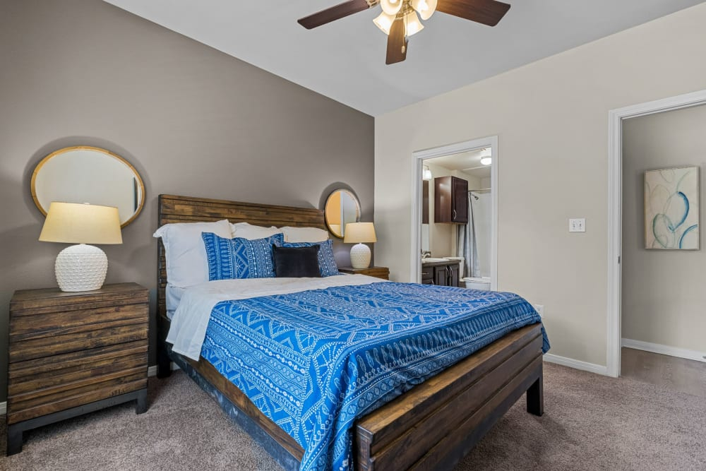 Bedroom with a ceiling fan at Brooks on Preston in Plano, Texas