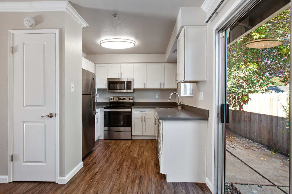 A large kitchen with white cabinets at Spring Lake Apartment Homes in Santa Rosa, California
