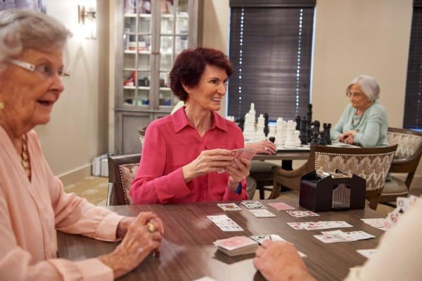 Residents playing cards in the game room at The Chamberlin in Hampton, Virginia
