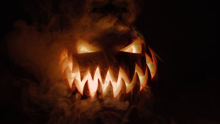 A spooky smoking pumpkin lurking in the shadows near Olympus Waterford