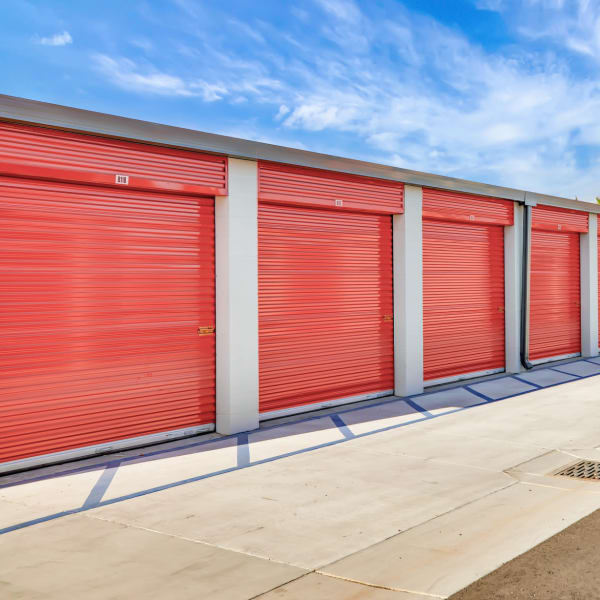 Outdoor storage units with red doors at StorQuest Self Storage in Sacramento, California