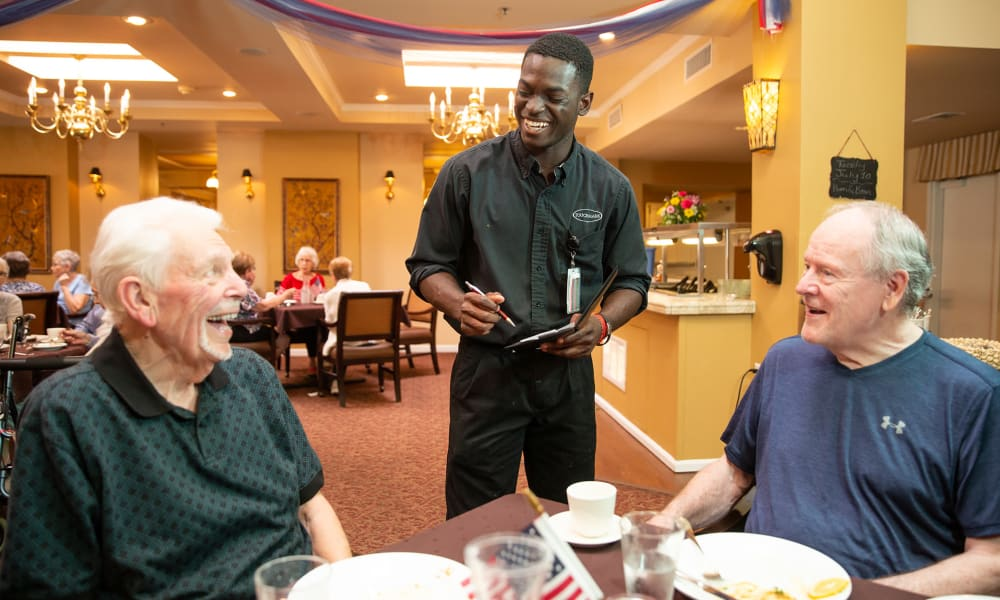 A resident from Touchmark at All Saints in Sioux Falls, South Dakota enjoying a meal