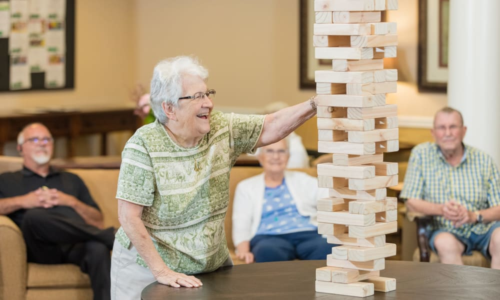 A resident from Touchmark at Fairway Village in Vancouver, Washington playing Jenga