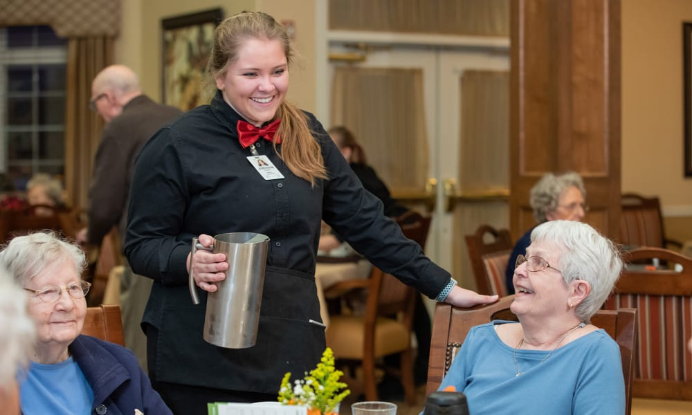 A resident ordering her meal at Touchmark on West Prospect in Appleton, Wisconsin