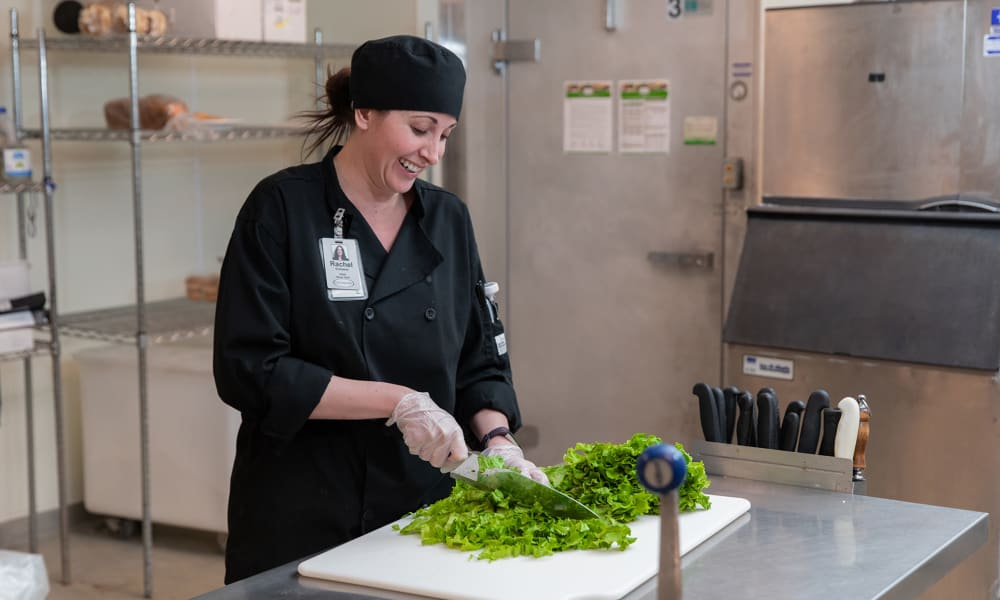 Chef preparing vegetables for residents at Touchmark on West Prospect in Appleton, Wisconsin