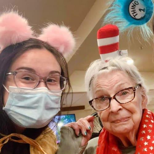 Resident and team member dressed up at Oxford Senior Living in Wichita, Kansas