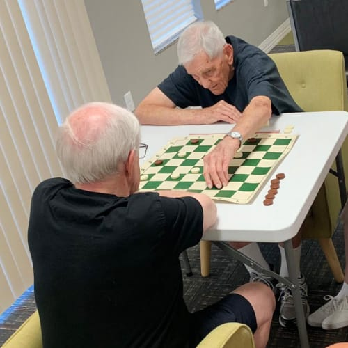 Residents playing a game at Oxford Villa Active Senior Apartments in Wichita, Kansas