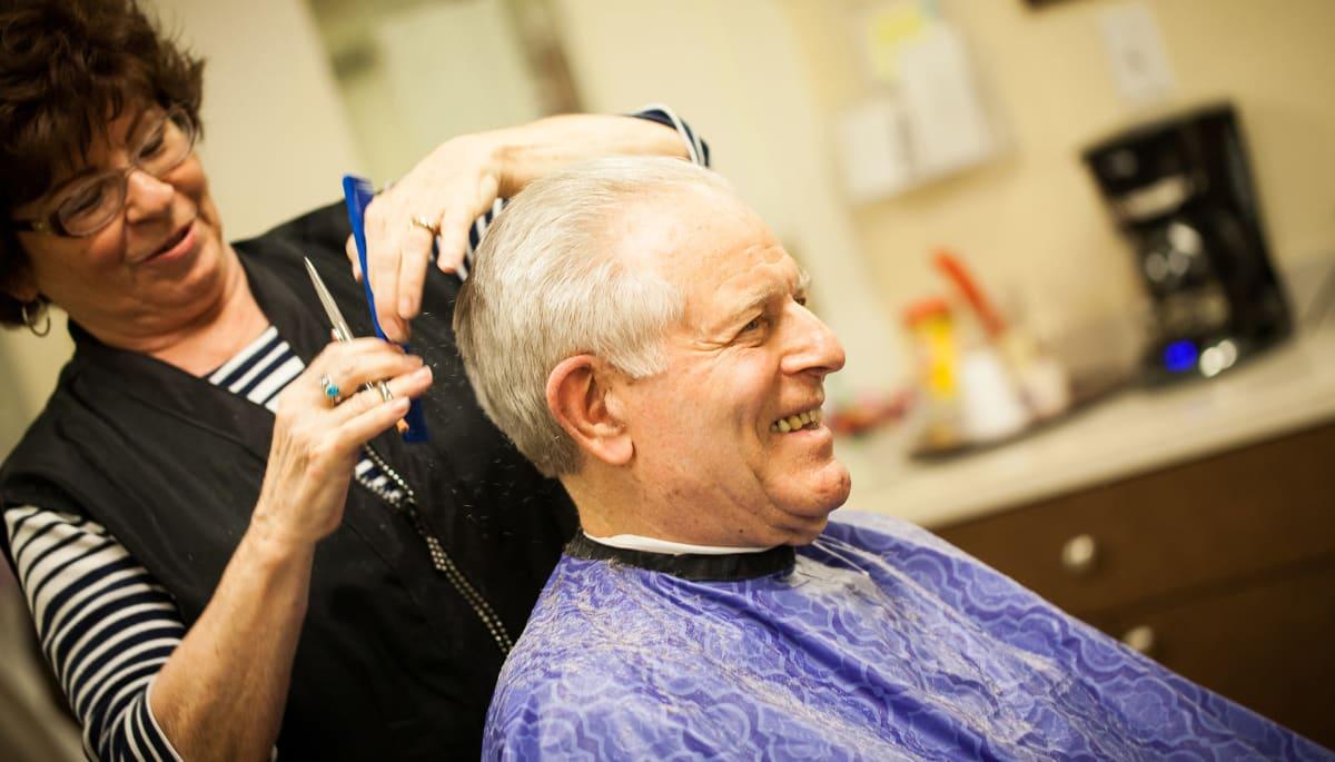 senior man receiving a haircut