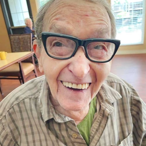 A happy resident of Oxford Glen Memory Care at Sachse in Sachse, Texas