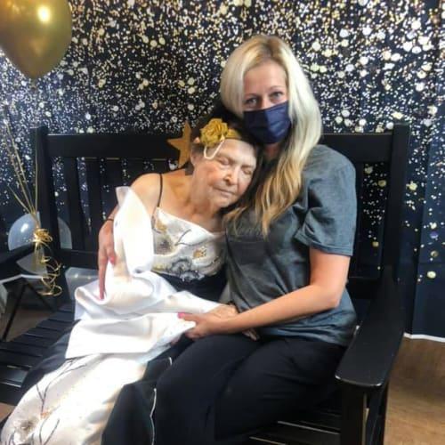 Resident snuggling with team member at Oxford Senior Living in Wichita, Kansas