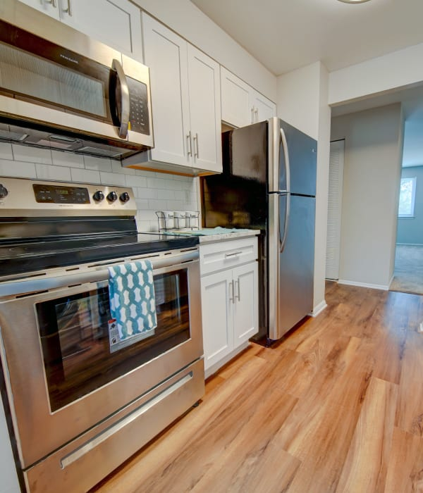 Stainless steel appliances at Beacon Pointe Apartments & Townhomes in Sparrows Point, Maryland
