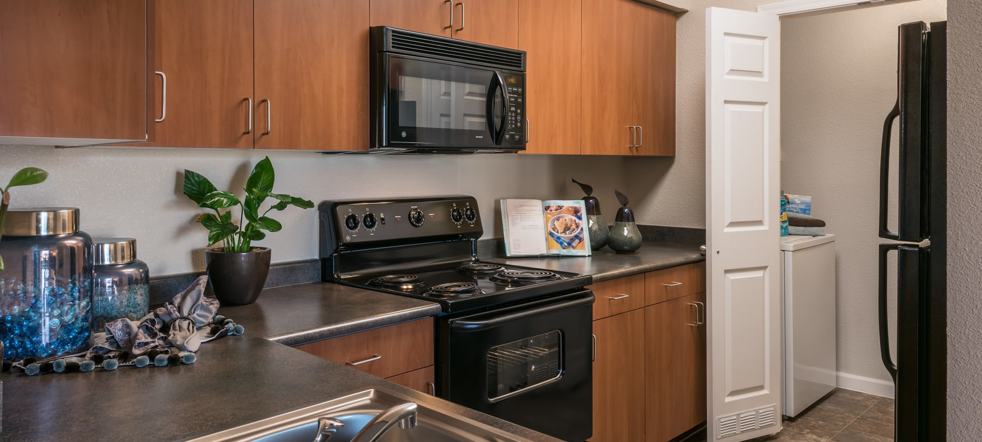 Inviting kitchen with laundry room at Azul at Spectrum in Gilbert, Arizona