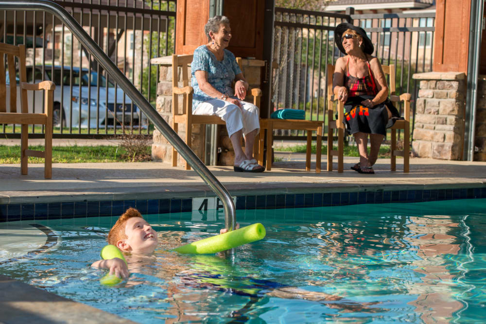 Residents enjoying the pool at Watercrest at Kingwood in Kingwood, Texas