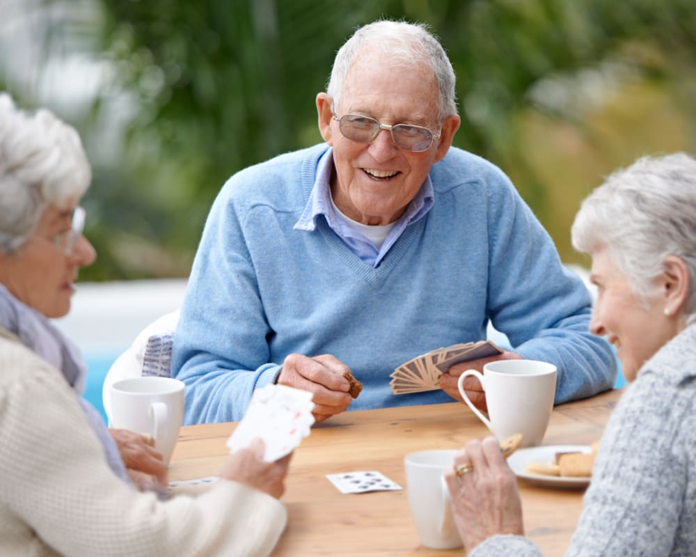 Residents play card game outdoors at Holstein Senior Living in Holstein, Iowa.